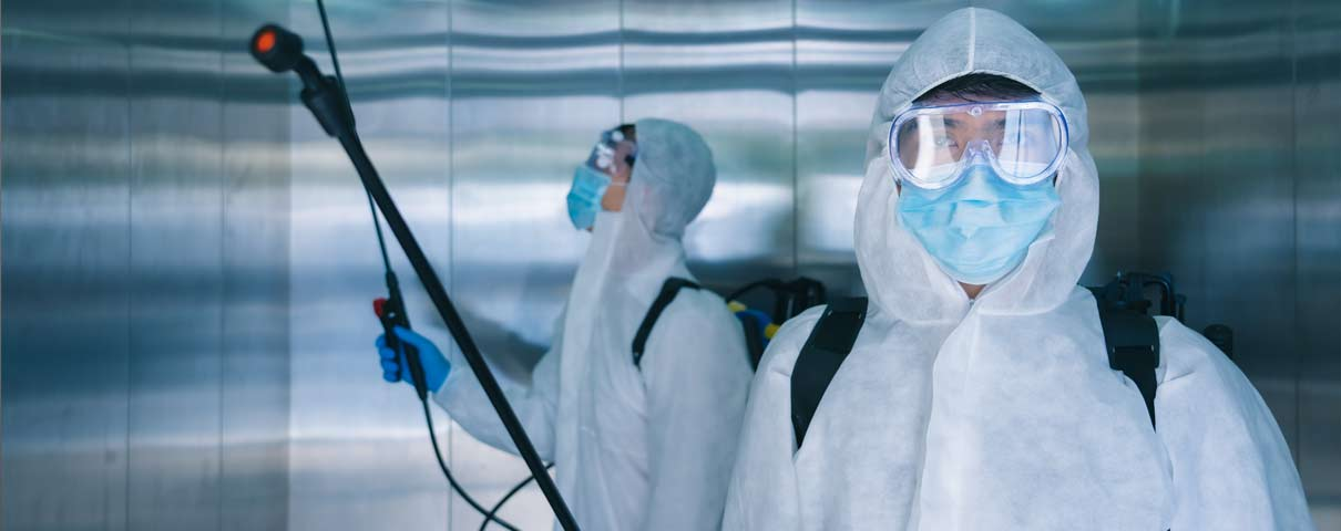 Covid disinfecting team in Chicago elevator
